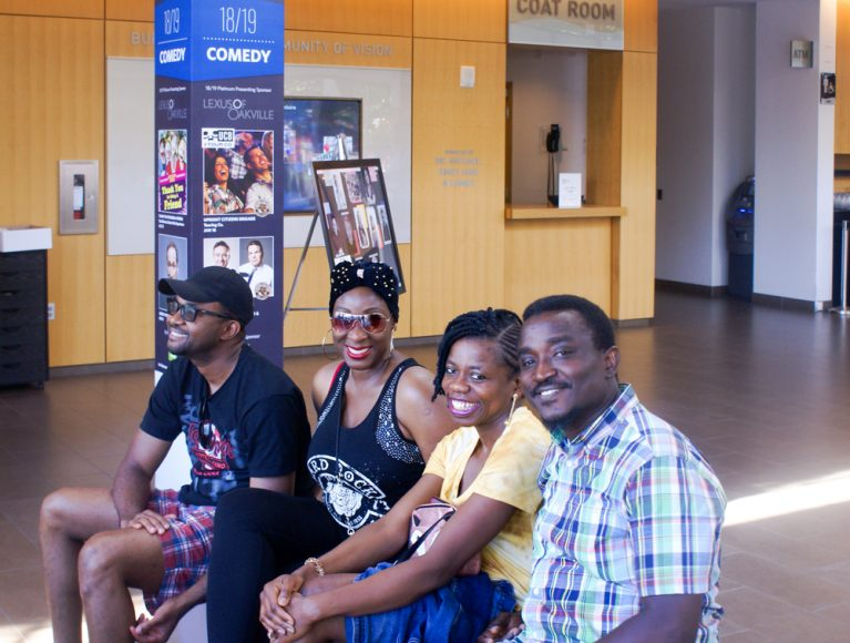 Enjoying the jazz, out of the sun are Emmanuel, Cecilia, Roli, and Segun.