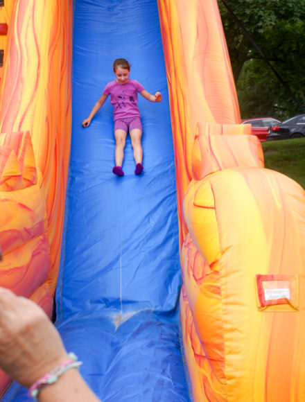 Shayna flies down the slide.