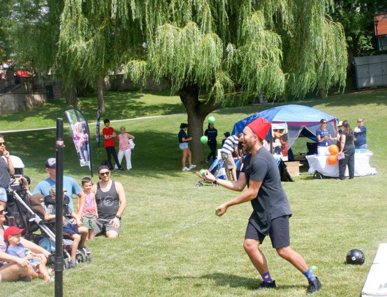 Performance artist Alex Kazam juggles for the kids