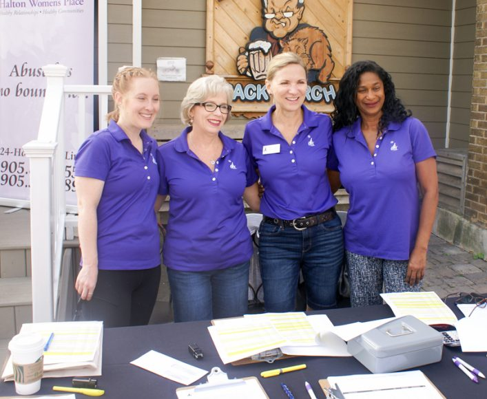 Volunteers Kaitlin, Sam, Janice and Janet at registration desk