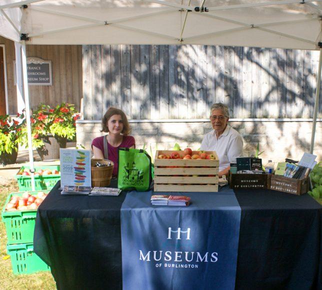 Megan and Pat distribute free apples
