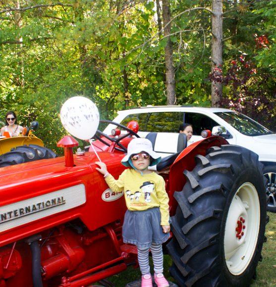 Elizabeth, 3 on the B414 tractor
