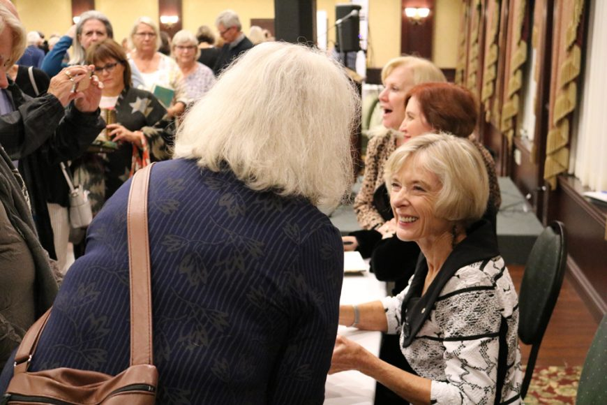 Authors signing books for fans