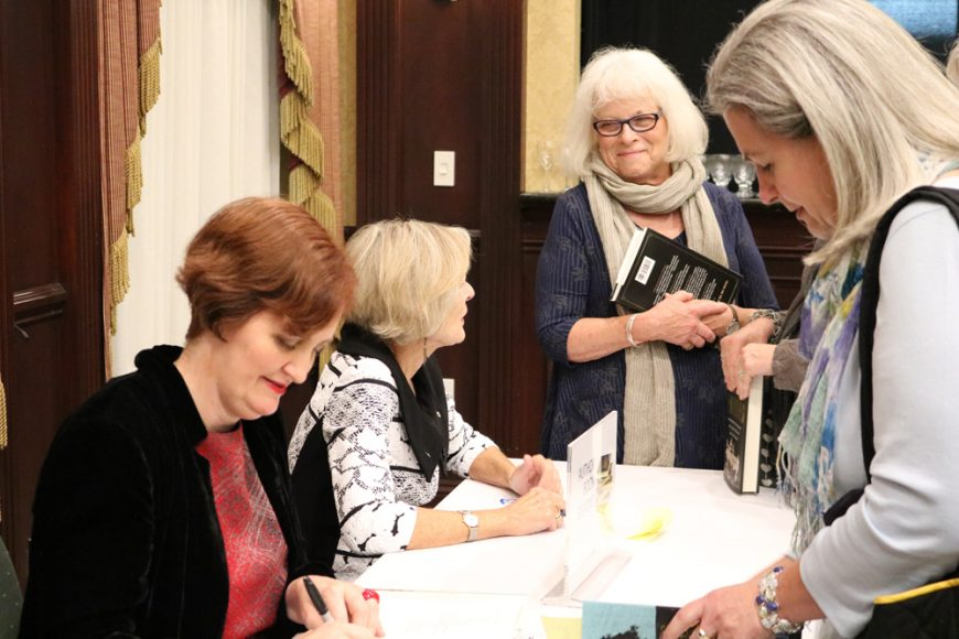 Authors stayed after their talks to sign books