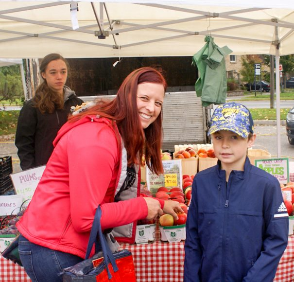 Astrid and Tristan get apples from Fenwick Berry Farm