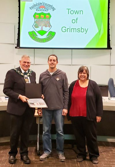 Best Commercial Entry - Miller Waste Systems L to R - Mayor Jeff Jordan, Kyle Howes, Parade Chair Robin Bradley